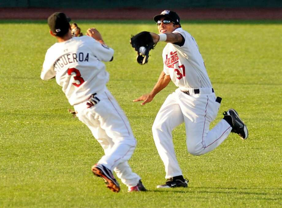Valley Cats center fielder Wilton Infante (37), right, catches a fly ball and then collides with teammate Oscar Figueroa (3) during their New York-Penn League baseball game against the Vermont Lake Monsters on Thursday at Joe Bruno Stadium in Troy. The ValleyCats won 5-2. (Cindy Schultz / Times Union) Photo: CINDY SCHULTZ