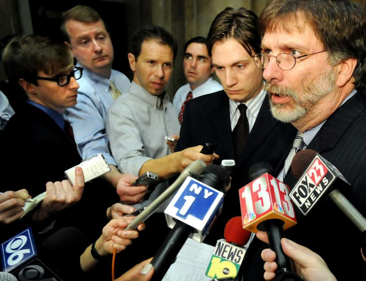 Cindy Schultz/Times Union Budget director Robert Megna, right, accompanied by Gov. Paterson?s press aide Morgan Hook, second from right, meet with the media Friday for a briefing on the progress of state budget talks. The governor is advocating a property tax cap. (Cindy Schultz/Times Union)