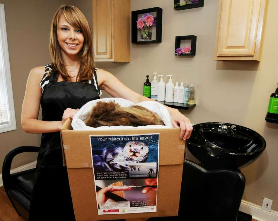 Kristen Gaffney, the owner of Pure Elements an Organic Salon in Guilderland, has been collecting hair used to make oil-absorbing booms for communities affected by the oil spill. (Luanne M. Ferris / Times Union) Photo: LUANNE M. FERRIS