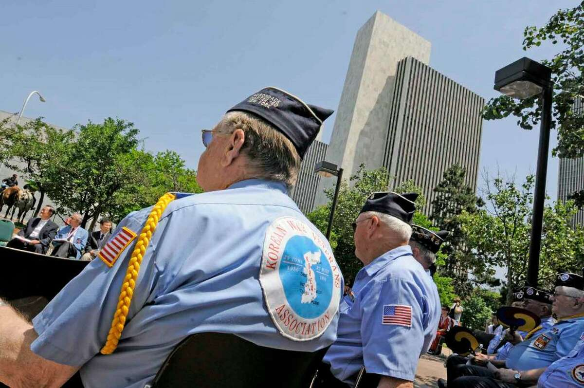 Korean War veteran Bill Shaw of Malta sits with other veterans during the Korean War 60th Anniversary Remembrance Ceremony in Albany on June 25, 2010. ( Michael P. Farrell / Times Union )