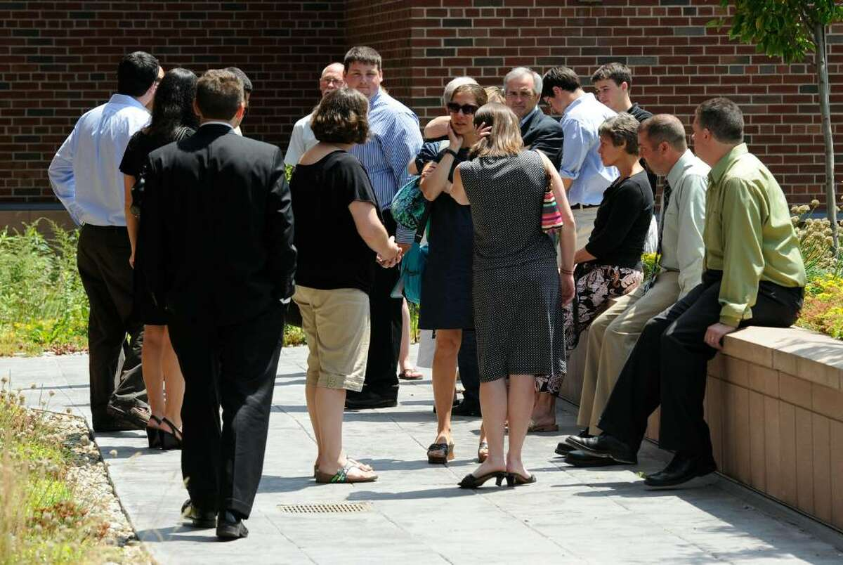 Friends and family of Ryan Rossley gather outside the courthouse in Ballston Spa on Friday, June 25, 2010, after attending the sentencing of Travis Carroll for Rossley's death. (Skip Dickstein/Times Union)