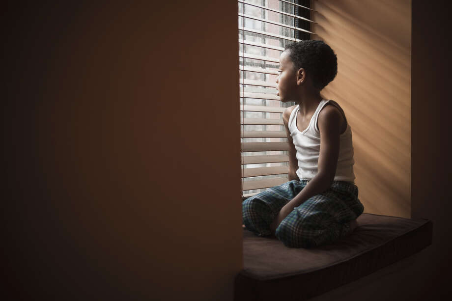 Many African-American parents are faced with the reality that their sons will grow up to earn less simply because of their race. Photo: Jose Luis Pelaez / Getty Images