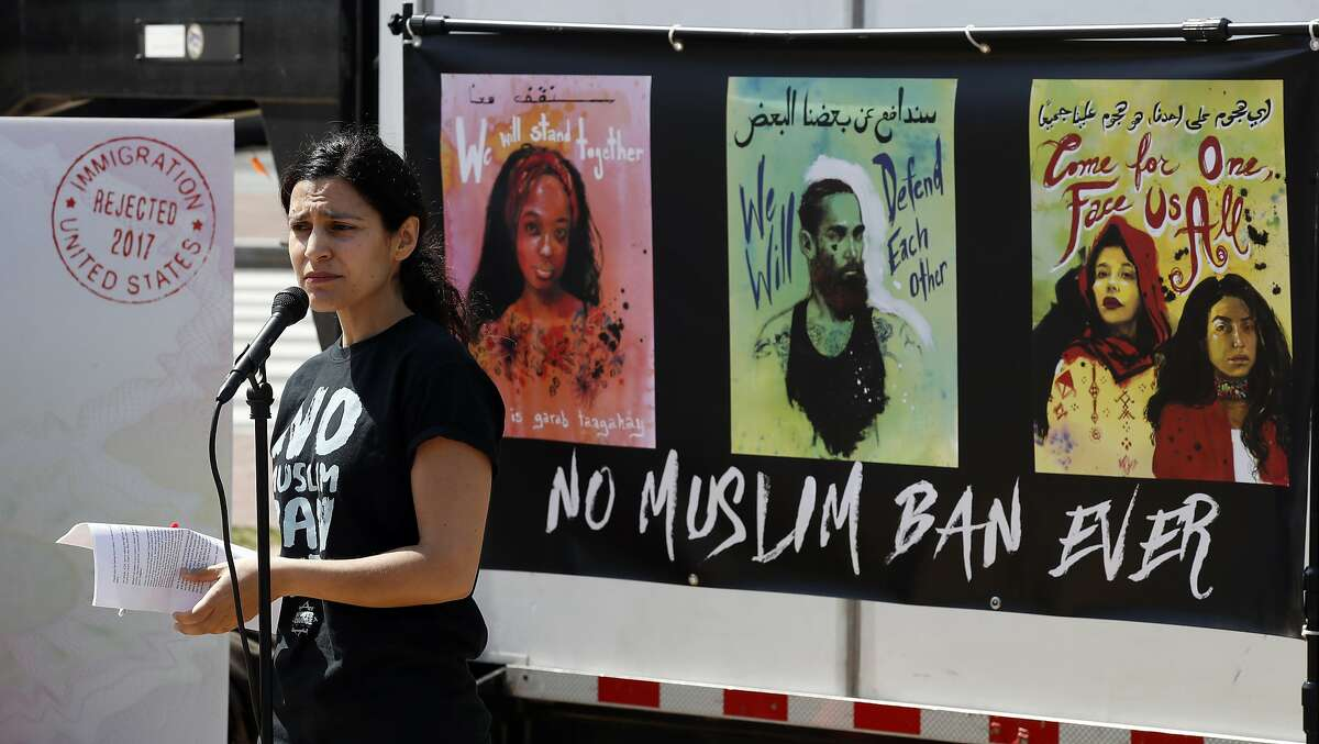 """Avideh Moussavian, Senior Policy Attorney, National Immigration Law Center, speaks during a media availability for a video installation to protest President Donald Trump's ban on Muslims, Monday, April 23, 2018, at Union Station in Washington. Nearly two hundred organizations engaged in advocacy efforts to fight back against the Muslim ban have joined together for the """"No Muslim Ban Ever,"""" campaign. (AP Photo/Alex Brandon)"""