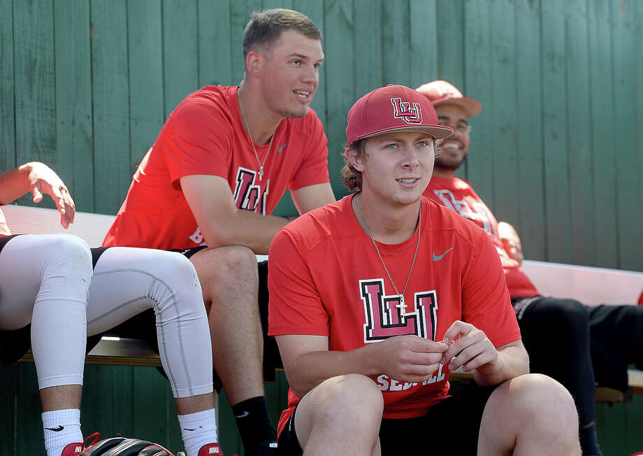 West Orange - Stark graduate Jack Dallas watches as fellow members of Lamar's pitching crew practice. Dallas, who was a redshirt with the football team this season, is one of two dual-sport athletes playing for the Cardinals. Freshman Kirkland Banks also plays for the football team and is a redshirt freshman for baseball. Photo taken Thursday, April 19, 2018 Kim Brent/The Enterprise Photo: Kim Brent, Beaumont Enterprise / BEN