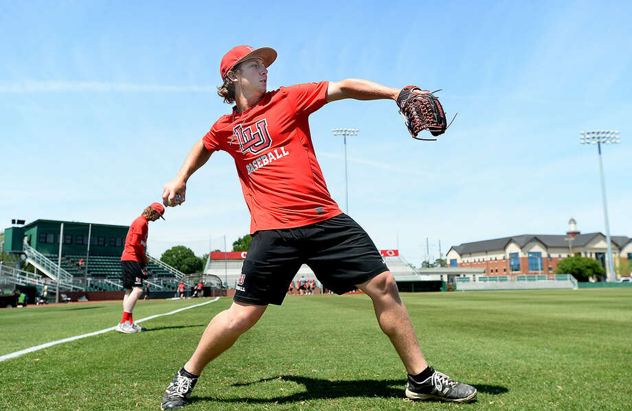 West Orange-Stark graduate Jack Dallas throws as he and members of the Lamar's pitching crew practice. Dallas, who was a redshirt with the football team this season, is one of two dual-sport athletes playing for the Cardinals. Freshman Kirkland Banks also plays for the football team and is a redshirt freshman for baseball.