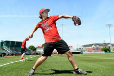 West Orange-Stark graduate Jack Dallas throws as he and members of the Lamar's pitching crew practice. Dallas, who was a redshirt with the football team this season, is one of two dual-sport athletes playing for the Cardinals. Freshman Kirkland Banks also plays for the football team and is a redshirt freshman for baseball. Photo taken Thursday, April 19, 2018 Kim Brent/The Enterprise