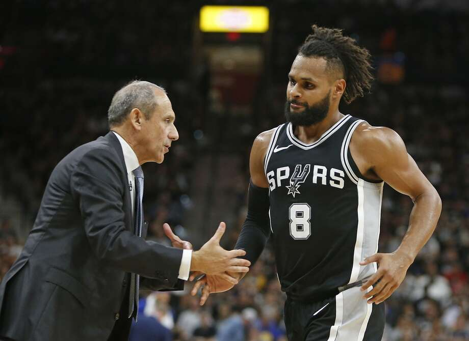 SAN ANTONIO,TX - APRIL 22 :  Ettore Messina greets Patty Mills #8 of the San Antonio Spurs during the game against the Golden State Warriors in the second half of Game Four of Round One of the 2018 NBA Playoffs  at AT&T Center on April 22 , 2018  in San Antonio, Texas.  NOTE TO USER: User expressly acknowledges and agrees that , by downloading and or using this photograph, User is consenting to the terms and conditions of the Getty Images License Agreement. (Photo by Ronald Cortes/Getty Images) Photo: Ronald Cortes / Getty Images