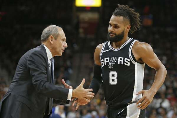 SAN ANTONIO,TX - APRIL 22 :  Ettore Messina greets Patty Mills #8 of the San Antonio Spurs during the game against the Golden State Warriors in the second half of Game Four of Round One of the 2018 NBA Playoffs  at AT&T Center on April 22 , 2018  in San Antonio, Texas.  NOTE TO USER: User expressly acknowledges and agrees that , by downloading and or using this photograph, User is consenting to the terms and conditions of the Getty Images License Agreement. (Photo by Ronald Cortes/Getty Images)