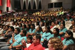 Concerned parents filled Stephen F. Austin High School  auditorium for the Fort Bend ISD's final community meeting on Wednesday, April 11, 2018, in Sugar Land. The meeting was meant to review potential changes to campus attendance zones and program offerings. Many more parents had to stand or sit on the floor throughout the meeting. ( Yi-Chin Lee / Houston Chronicle )