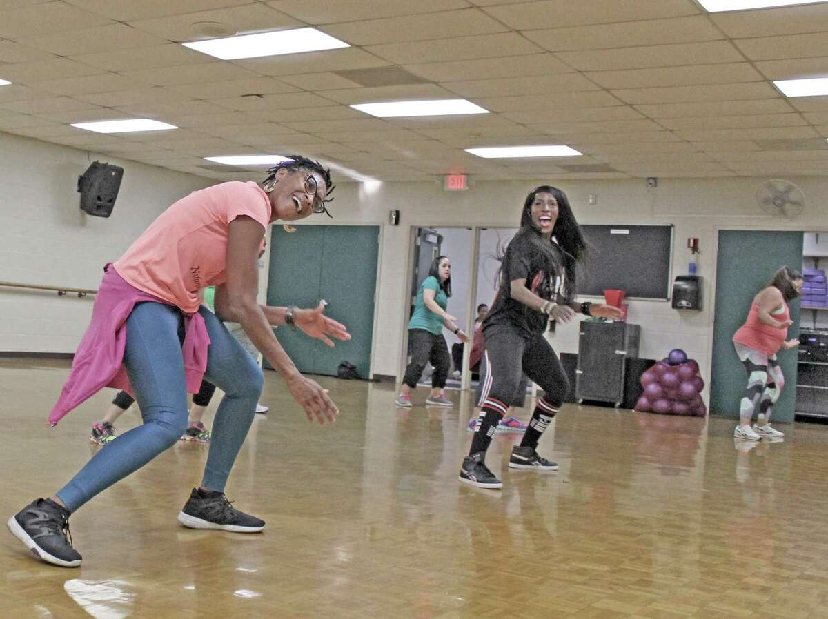 According to researchers from the from the World Cancer Research Fund and the American Cancer Research Institute, the risk of postmenopausal breast cancer is greatly reduced by being physically active and maintaining a healthy body weight. In this 2019 file photo, execise instructor Jennifer Breedlove leads students in a U-Jam classes.