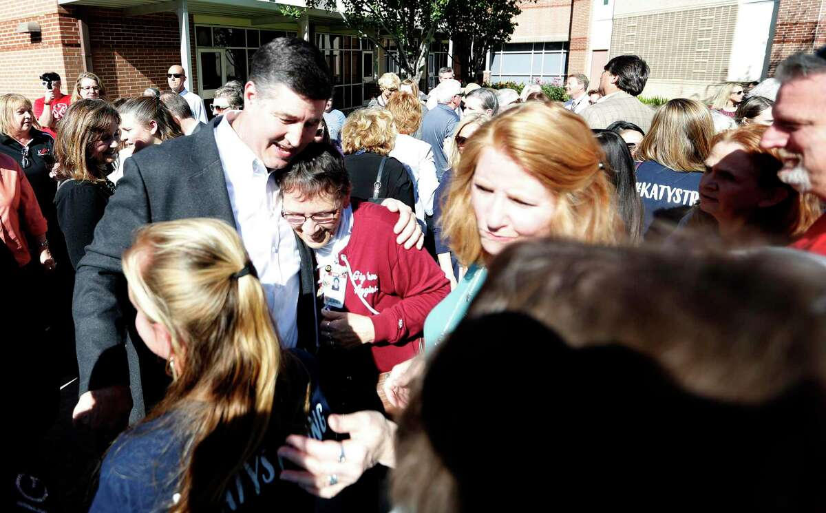 File photo from April 16, 2018 shows then-Katy ISD Superintendent Lance Hindt surrounded by members of the school district community who organized a support circle and rally before a school board meeting. The parents and others backed Hindt as he faced allegations of middle school bullying. He announced his resignation weeks later.