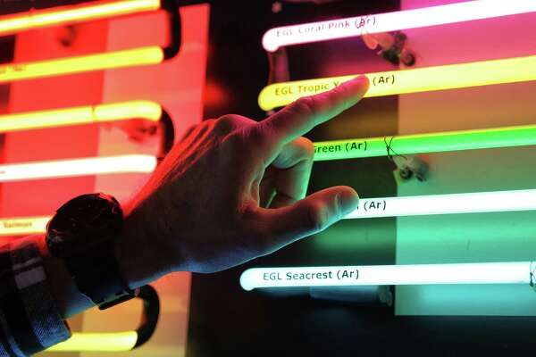 Western Neon creative director Dylan Neuwirth explains the differences in the various gasses used to create neon lighting, April 4, 2018.  Though they take their namesake from neon, other noble gasses, including argon, helium, xenon and krypton, are also used to make the glass tubes glow.