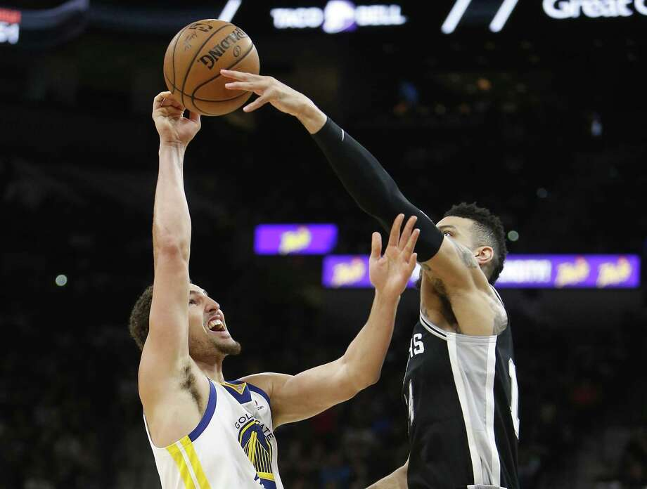 SAN ANTONIO,TX - APRIL 22 :  Danny Green #14 of the San Antonio Spurs blocks a shot attempt of Klay Thompson #11 of the Golden State Warriors in the second half of Game Four of Round One of the 2018 NBA Playoffs  at AT&T Center on April 22 , 2018  in San Antonio, Texas.  NOTE TO USER: User expressly acknowledges and agrees that , by downloading and or using this photograph, User is consenting to the terms and conditions of the Getty Images License Agreement. (Photo by Ronald Cortes/Getty Images) Photo: Ronald Cortes, Stringer / Getty Images / 2018 Getty Images
