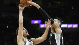 SAN ANTONIO,TX - APRIL 22 :  Danny Green #14 of the San Antonio Spurs blocks a shot attempt of Klay Thompson #11 of the Golden State Warriors in the second half of Game Four of Round One of the 2018 NBA Playoffs  at AT&T Center on April 22 , 2018  in San Antonio, Texas.  NOTE TO USER: User expressly acknowledges and agrees that , by downloading and or using this photograph, User is consenting to the terms and conditions of the Getty Images License Agreement. (Photo by Ronald Cortes/Getty Images)
