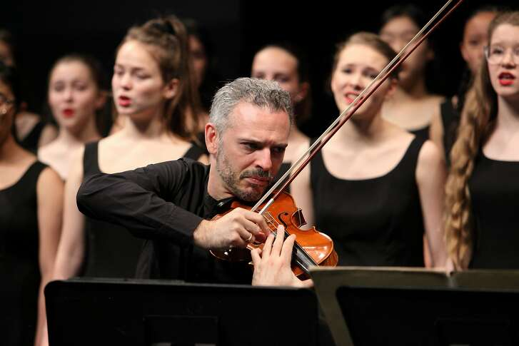 Composer-violinist Colin Jacobsen with the San Francisco Girls Chorus