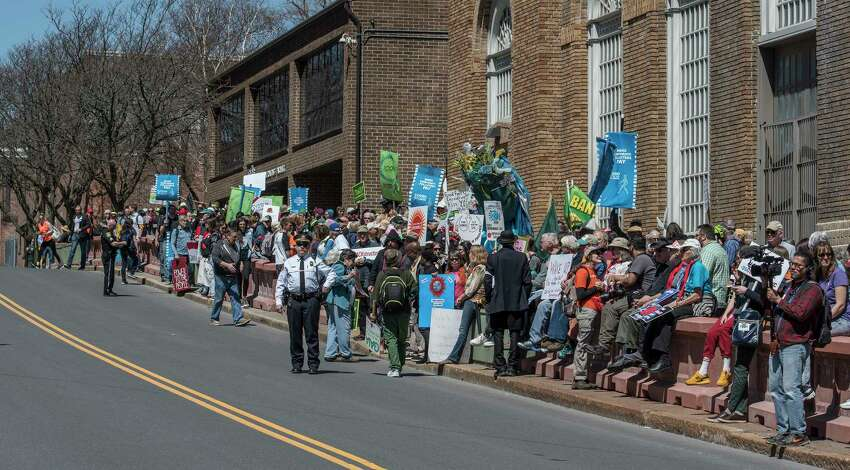 A large crowd gathered for the Walk the Talk on Climate! Day of Action rally as they prepare to march on the State Capitol building on Monday, April 23, 2018, in Albany, N.Y. (Skip Dickstein/Times Union)