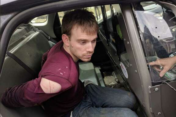 "This image released by the Metropolitan Nashville Police Department, shows Travis Reinking after he was captured by police on April, 23, 2018, in Nashville, Tennessee.  Police on Monday captured the suspected gunman who killed four people in a shooting at a Waffle House restaurant in Nashville. ""Murder suspect Travis Reinking is in custody. Arrested moments ago,"" Nashville's police department tweeted.  / AFP PHOTO / Metropolitan Nashville Police Department / Jose ROMERO / RESTRICTED TO EDITORIAL USE - MANDATORY CREDIT ""AFP PHOTO / Metropolitan Nashville Police Department"" - NO MARKETING NO ADVERTISING CAMPAIGNS - DISTRIBUTED AS A SERVICE TO CLIENTS  JOSE ROMERO/AFP/Getty Images"