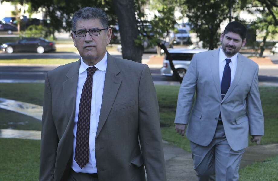 Former Mexican federal prosecutor and director of intelligence for the Mexican state of Jalisco Sergio Adame Ochoa Sr.,66, (left) and his son Sergio Adame Ochoa, Jr. (right) walk to the John H. Wood, Jr. Federal Courthouse Monday April 23, 2018. The senior Adame Ochoa is being sentenced for lying to a bank and the junior Adame Ochoa entered a guilty plea on behalf of Allen Land LP and Allen Management LLC to a single count of conspiracy to launder money. Photo: John Davenport, STAFF / San Antonio Express-News / ©John Davenport/San Antonio Express-News