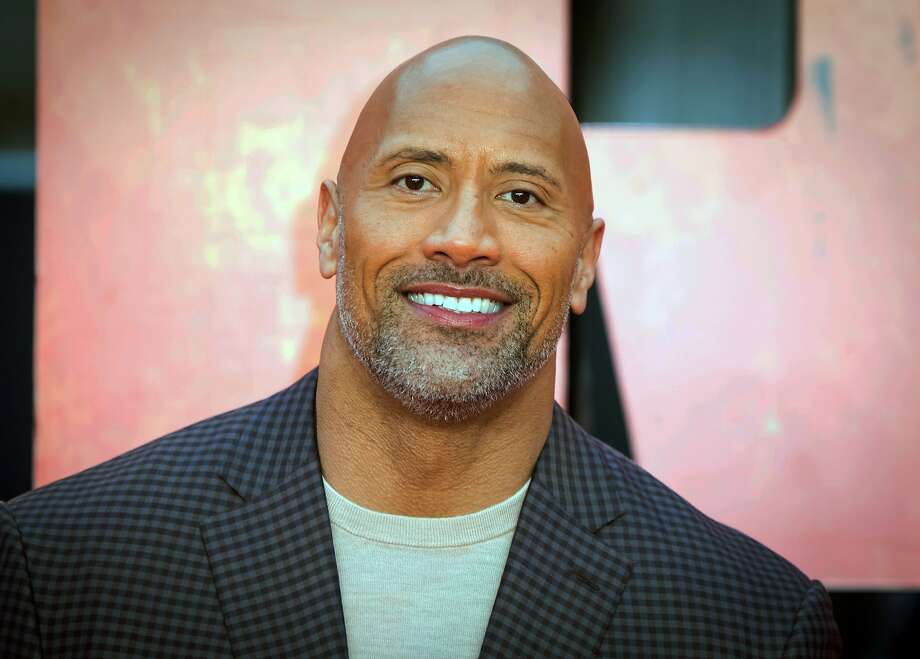 Actor Dwayne Johnson spoke out on Twitter about the lack of national leadership surrounding the killing of George Floyd and the subsequent protests. Photo: Vianney Le Caer, Associated Press