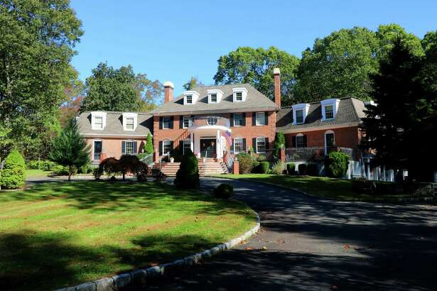 The 15-room custom red brick colonial house at 20 Cherry Lane is walking distance to Cherry Lane Park.