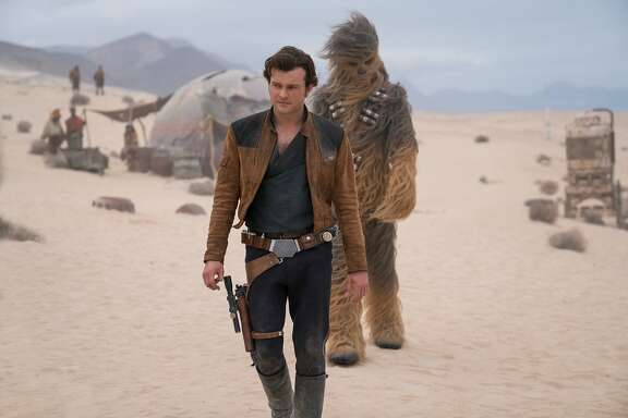 "In this image released by Lucasfilm, Alden Ehrenreich and Joonas Suotamo appear in a scene from ""Solo: A Star Wars Story,"" in theaters on May 25. (Jonathan Olley/Lucasfilm via AP)"