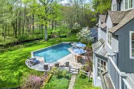 A river runs through the backyard of this 7.8-acre property at 8&10 Pent Road the foot of Devil's Den in Weston, where there is also an in-ground swimming pool, cabana, and care-taker's apartment.