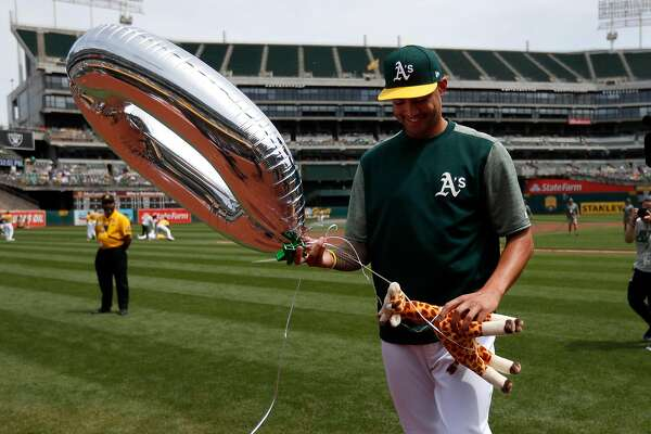 "Oakland Athletics' Sean Manaea (55) holds an inflatable ""0"" and a giraffe in celebration of his no-hitter the previous night before the Oakland Athletics game against the Boston Red Sox on Sunday, April 22, 2018 at the Oakland Coliseum in Oakland, Calif. (Nhat V. Meyer/Bay Area News Group/TNS)"