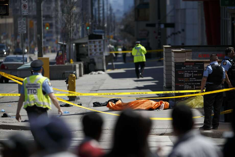 A tarp lays on top of a body on Yonge St. at Finch Ave. after a van plowed into pedestrians on April 23, 2018 in Toronto, Canada. A suspect is in custody after a white van collided with multiple pedestrians. (Photo by Cole Burston/Getty Images) Photo: Cole Burston / Getty Images