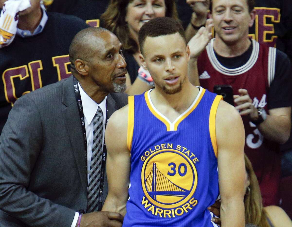 According to The Athletic, the jacket belongs to Warriors head of security, Ralph Walker, seen here with Steph Curry in 2016.