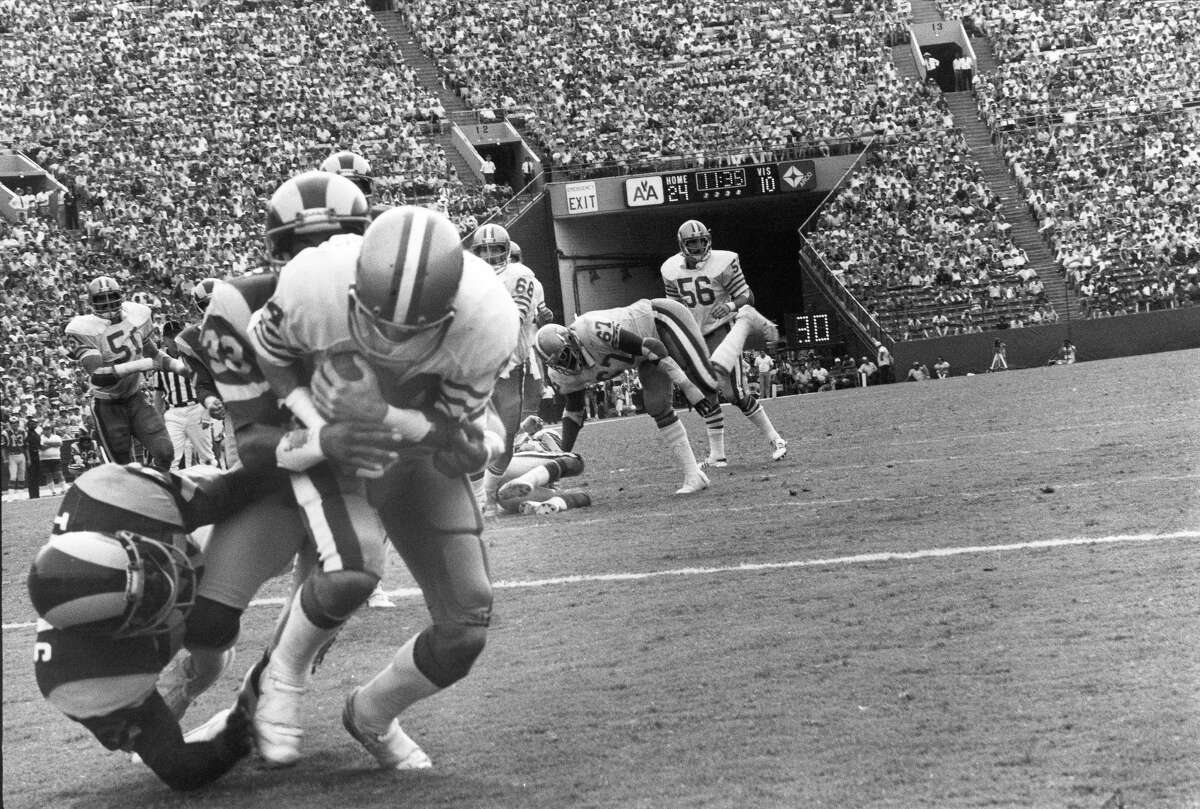 Wide receiver Mike Shumann #84 of the San Francisco 49ers catches a pass for a touchdown against cornerback Dwayne O'Steen #33 of the Los Angeles Rams at the Los Angeles Memorial Coliseum on September 16, 1979 in Los Angeles, California. The Rams defeated the Niners 27-24. (Photo by Michael Zagaris/Getty Images)