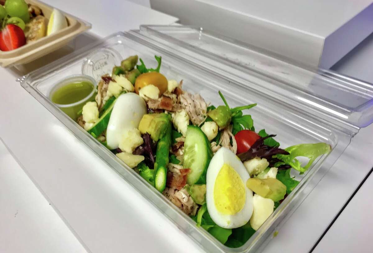 Inflight food service, such as this Cobb Salad served in economy class on Alaska Airlines, has been suspended