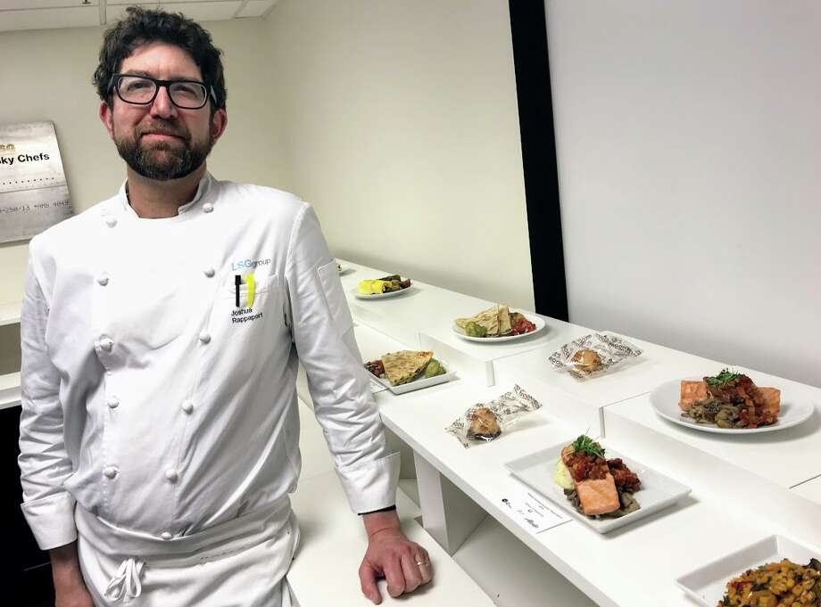 Chef Joshua Rappaport alongside his culinary creations for Alaska Airlines first and economy class passengers Photo: Chris McGinnis
