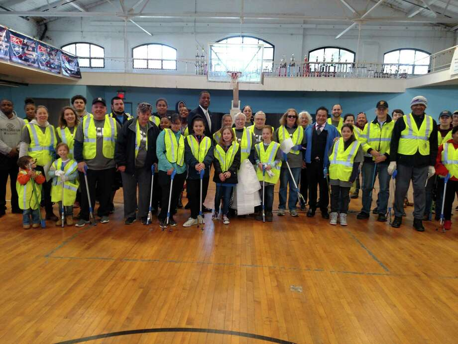 More than 40 volunteers turned out Saturday in Ansonia to participate in the city's 2nd annual Earth Day Clean-up. Photo: Contributed Photo / Greg Martin - Ansonia City Hall