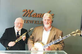 Bud Shultz, left, of the You Can't Experience Jazz Band, and Mike Harman, of The Harman Family Bluegrass Band