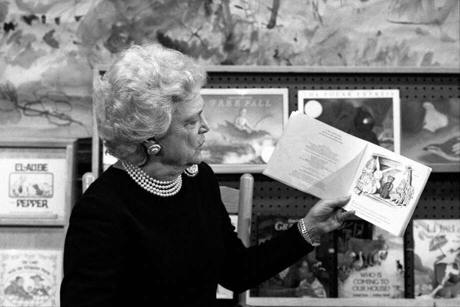 First lady Barbara Bush reads to children at a day care center in New York in 1990. A reader praises Bush, who died last week. Photo: File Photo /New York Times / NYTNS