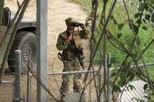 A National Guard troop watches over the Rio Grande in Roma on April 10. Want to really stem undocumented immigration? Go after employers.