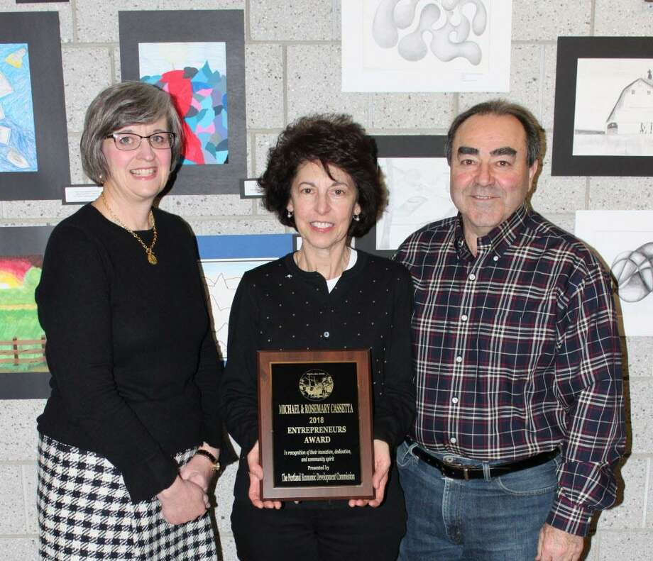 Mary Dickerson, Portland's economic development coordinator, left, presents the entrepreneurial award to Dairy Queen owners Michael and Rosemary Cassetta, to her right. Photo: Contributed Photo