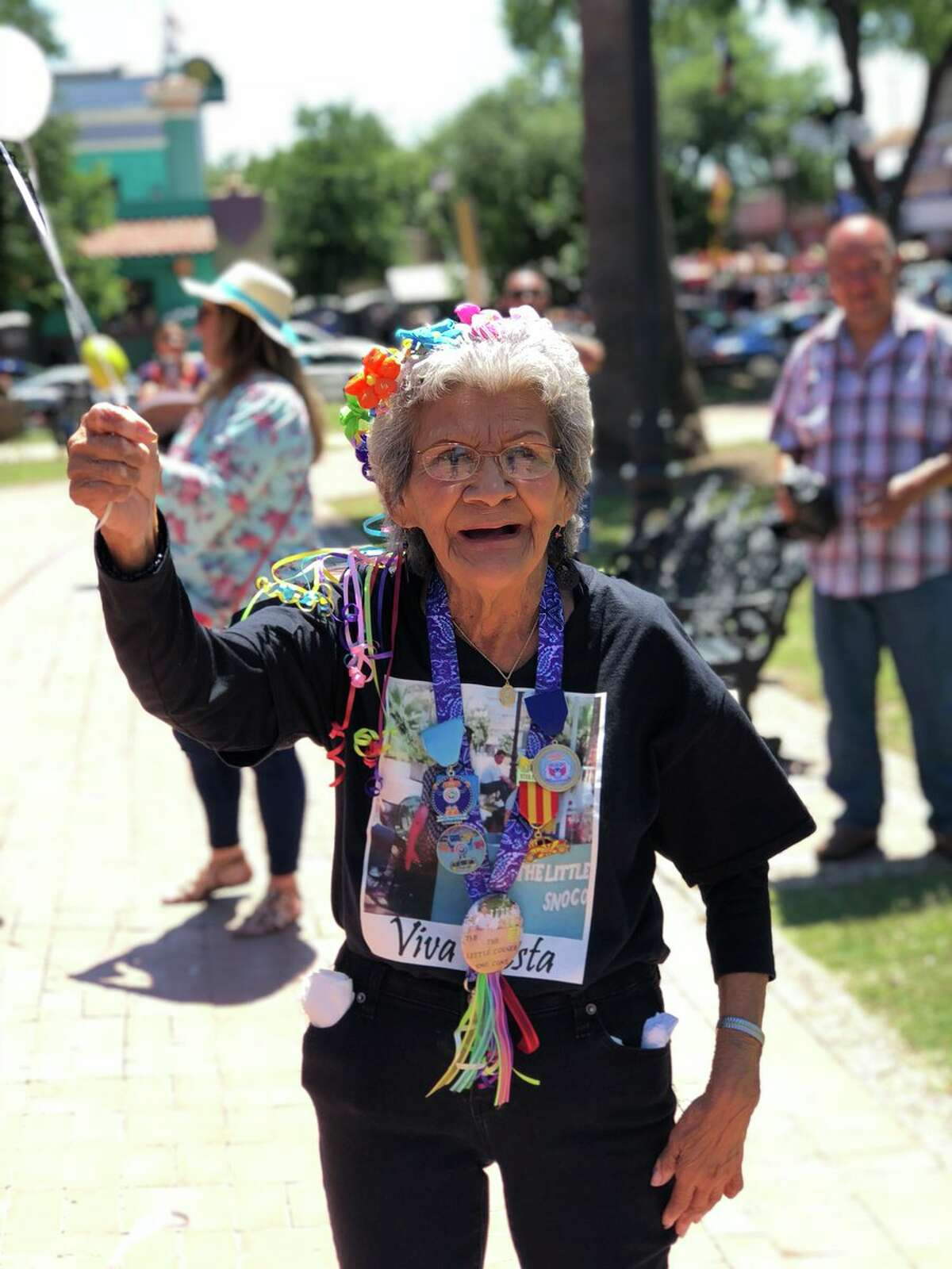 """@reggierivera10: """"So Every fiesta we go to market square to let balloons go for my grandpa who passed away and had a snow cone stand there for many years, and my grandma looked pretty excited to send him a balloon."""""""