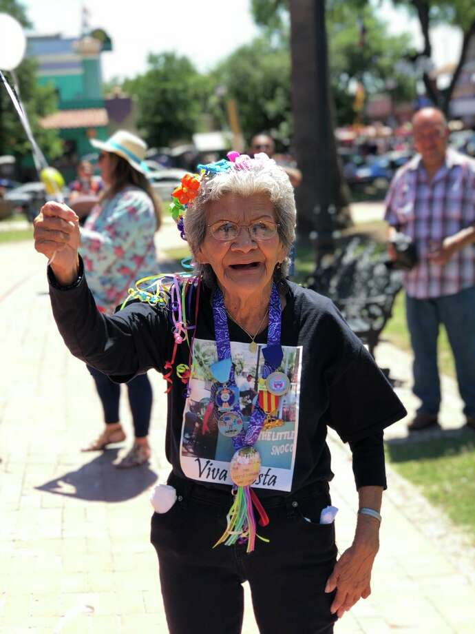 """@reggierivera10: """"So Every fiesta we go to market square to let balloons go for my grandpa who passed away and had a snow cone stand there for many years, and my grandma looked pretty excited to send him a balloon."""" Photo: Courtesy, Reggie Rivera"""