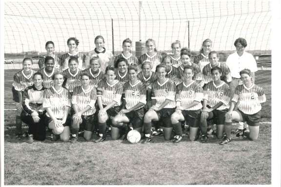 The Madison soccer team poses for a team photo in 1993.    Christine Morrison, Randi Bice, Amy Marlar, Molly Suess, Christina Saenz, Breana Denson, Anne Burch, Leslie Kennemer, Darcy McMichael, Polly Van Ess, Jayme Lindeman, Lisa Malone, Ricki Bice, Angie Lloyd, Malene Nielsen, Selena Solis, Erin Callaway, Jenny McMichael, Sarah Suess, Denise Holland, Janina Brown, Holly Barrow, Amy Nairn, Dawn Burnett, Kelly Shaughnessy, and Coach Audrey Ambrose. (No specific order)     (Courtesy University Interscholastic League)