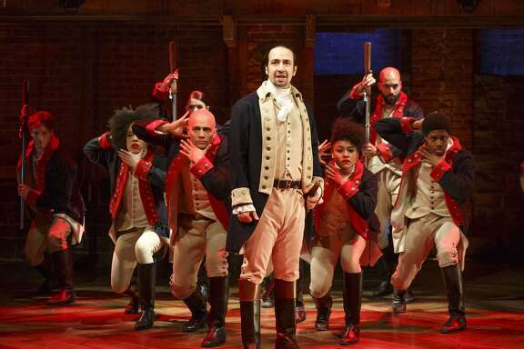 "Lin-Manuel Miranda, foreground, performs with members of the cast of the musical ""Hamilton"" in New York."