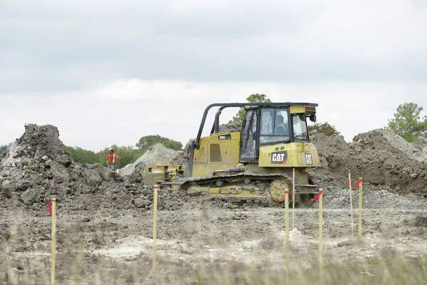 Construction is shown at the site of the of the former Pine Crest Golf Course, 3080 Gessner Rd., Tuesday, Oct. 31, 2017, in Houston. Scottsdale, Ariz.-based Meritage Homes announced last May that it planned to build hundreds of single-family homes on the site at Clay and Gessner in a master-planned community to be called Spring Brook Village. The finished project is expected to include some 800 houses. ( Melissa Phillip / Houston Chronicle )