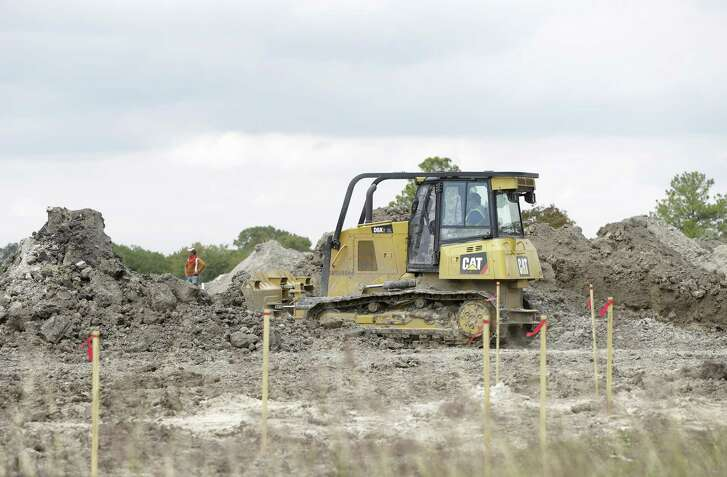 Construction is shown at the site of the of the former Pine Crest Golf Course at 3080 Gessner Road in Houston. Scottsdale, Ariz.-based Meritage Homes announced last May that it planned to build hundreds of single-family homes in a master-planned community to be called Spring Brook Village.