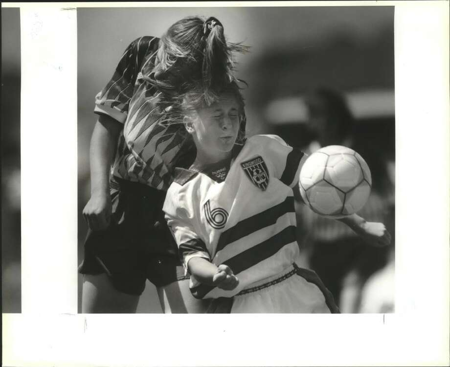 Madison's Angie Lloyd goes up for a header agaisnt Humble Kingwood's Morgan Rittenhouse during the 1993 state final. Madison rallied for a 2-1 win. (Express-News file photo)
