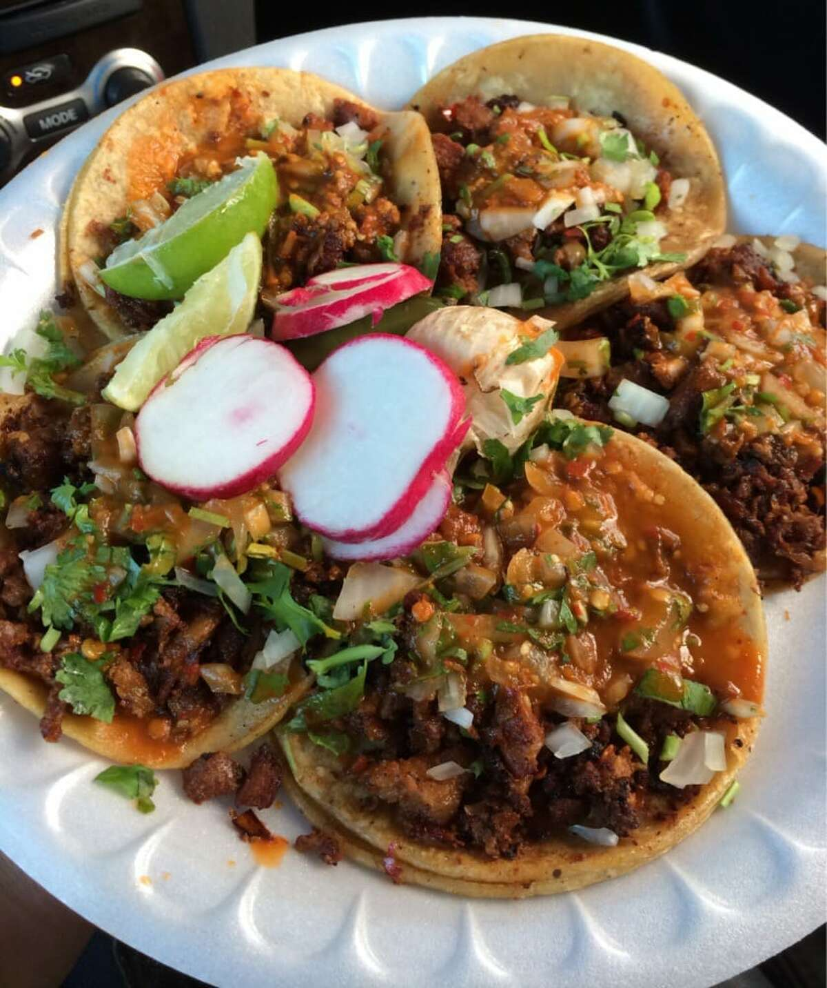 Tacos al pastor with the requisite sliced radish and limes at Oakland food truck, Tacos El Gordo.