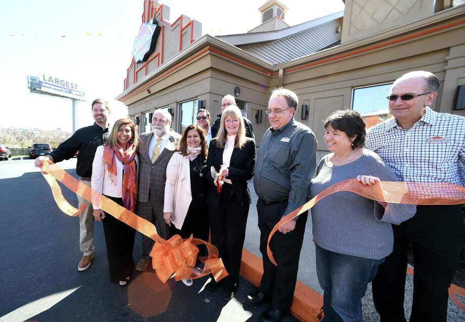 West Haven Mayor Nancy Rossi, center, cuts the ribbon for the grand opening of Stewart's All American Grill in West Haven Monday. Photo: Arnold Gold / Hearst Connecticut Media / New Haven Register
