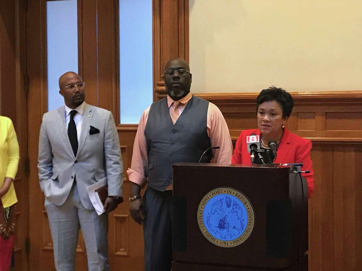 Mayor Toni N. Harp stands with Earl Bloodworth Monday to announce programming to support National Reentry Week.