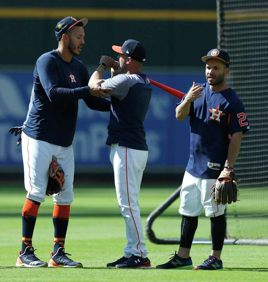 Houston Astros shortstop Carlos Correa (1) with bench coach Joe Espada (20) during batting practice before the start of an MLB game at Minute Maid Park, Monday, April 23, 2018, in Houston. Photo: Karen Warren, Houston Chronicle / © 2018 Houston Chronicle