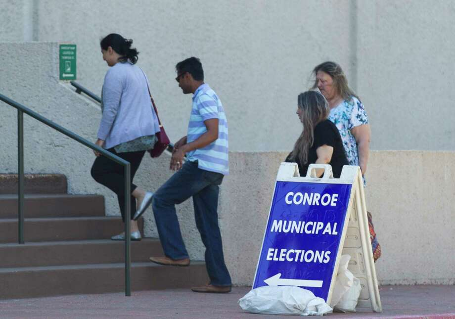 Residents enter Conroe Tower during the first day of early voting for the Conroe municipal elections, Monday, April 23, 2018, in Conroe. Photo: Jason Fochtman, Staff Photographer / © 2018 Houston Chronicle