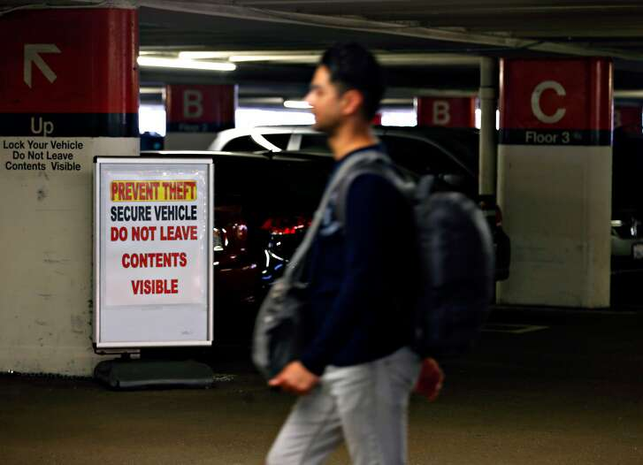 A man returns to his car parked in the Sutter Stockton Garage in San Francisco, Calif. on Saturday, April 21, 2018 where car break-ins have been an ongoing problem.